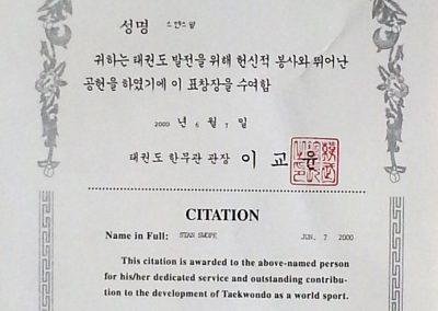 Grandmaster Stan Swope's certificate signed by Kyo Hoon Lee, founder of Han Moo Kwan
