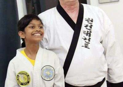 Grandmaster Stan Swope poses with a student in Malaysia, 2015