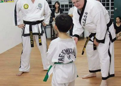 Grandmaster Stan Swope instructs a green belt in Malaysia, 2015