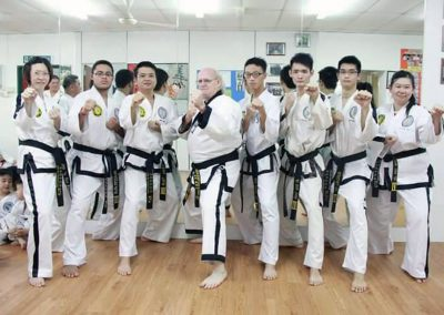 Grandmaster Stan Swope poses with black belts, Malaysia, 2015