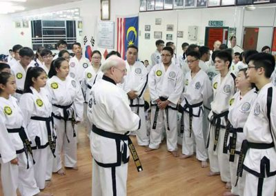 Grandmaster Stan Swope speaks to black belts in Malaysia 2015