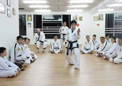 Grandmaster Swope watches black belt perform in Malaysia 2015