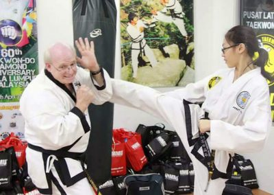 Grandmaster Stan Swope with black belt student in Malaysia