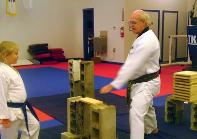 Grandmaster Stan Swope teaches during colored belt breaking seminar
