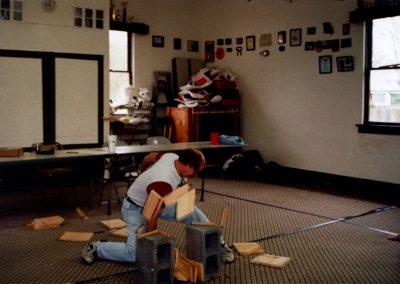 Grandmaster Stan Swope breaks wood at his dojang in Mulvane, KS
