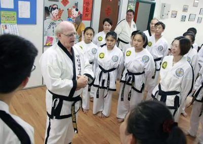 Grandmaster Stan Swope speaks to black belts in Malaysia, 2015