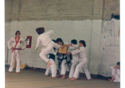 Grandmaster Stan Swope's white belt breaks with flying side kick during belt test circa 1983
