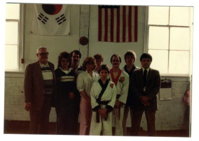 Grandmaster Stan Swope poses with family and martial arts instructors circa 1983