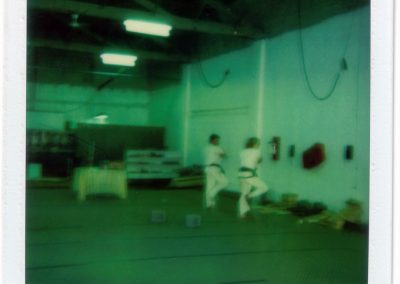 Grandmaster Stan Swope performing a pattern with one of his testing students