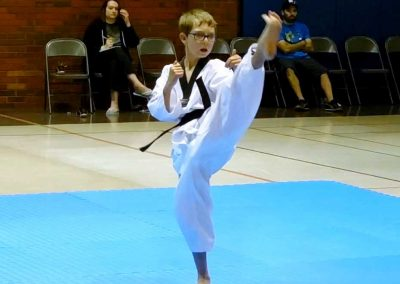 Stephen Swope performs a beautiful front kick during his 1st Dan testing (Chun Kuhn Taekwondo)