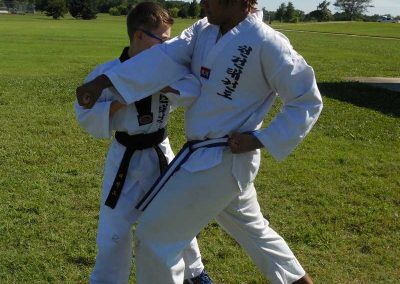 Stephen Swope performs the horse riding stance/elbow strike from Koryo poomsae during self-defense practice (Chun Kuhn Taekwondo)