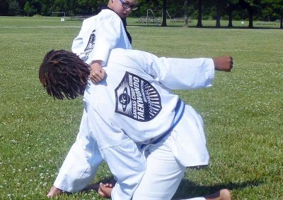 Stephen Swope performs the high block/side kick/hammer fist strike from Taegeuk 5 poomsae during self-defense practice (Chun Kuhn Taekwondo)