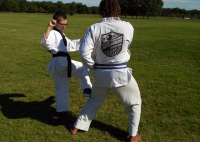 Stephen Swope executes horse stance/inward block from Keumgang poomsae during self-defense practice (Kansas Chun Kuhn Taekwondo)