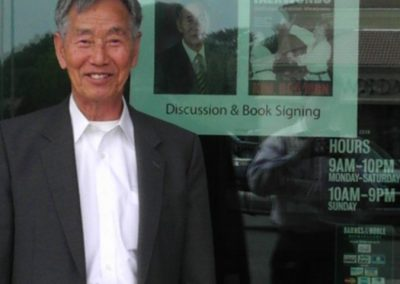 Supreme Master Kim Bok-Man poses outside Barnes & Noble Booksellers with a poster announcing his first ever book signing, organized by Master Mike Swope, prior to formation of Kansas Chun Kuhn Taekwondo