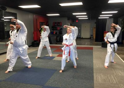 Kansas Chun Kuhn Taekwondo Students Practice Rising/High Blocks